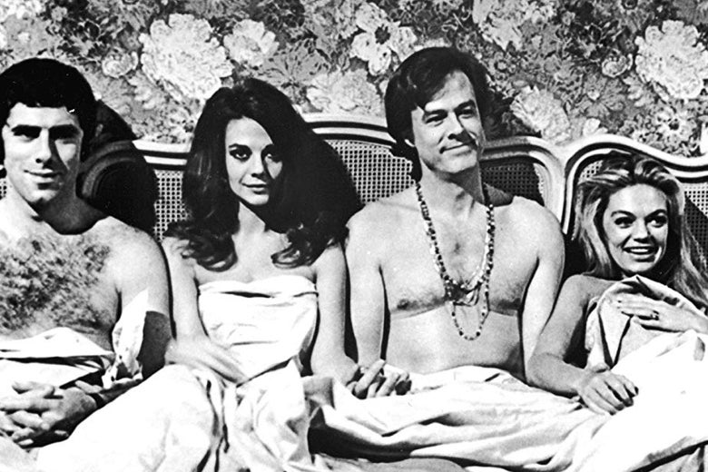 Elliott Gould, Natalie Wood, Robert Culp, and Dyan Cannon in this still from Bob & Carol & Ted & Alice. It is the iconic bed scene.