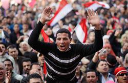 Egyptian people celebrate Mubarak's resignation. Click to expand image.