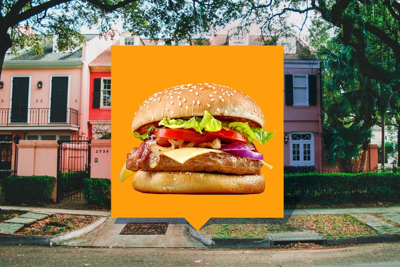 An augmented reality burger ad pops up over a house.