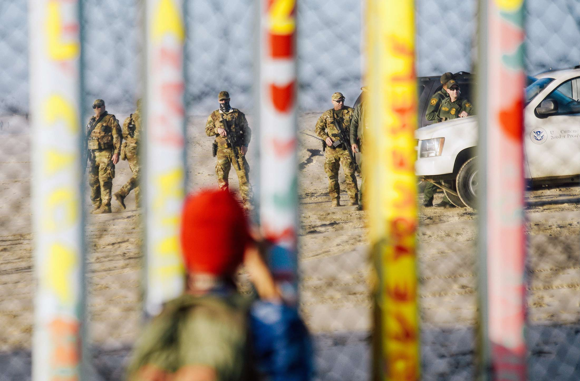 Border Patrol agents stand along the U.S.-Mexico border.