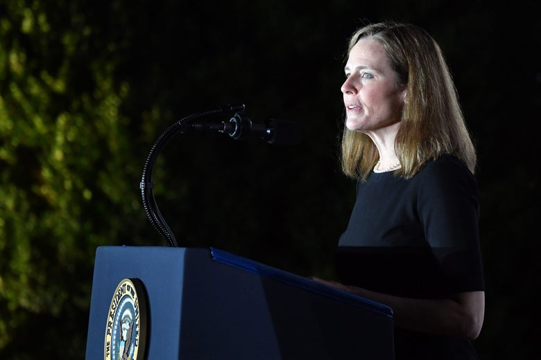 Amy Coney Barrett speaks at the White House after her confirmation to the Supreme Court.