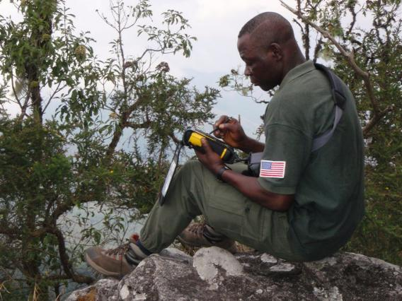 A wildlife ranger logs GPS data to be uploaded into SMART.