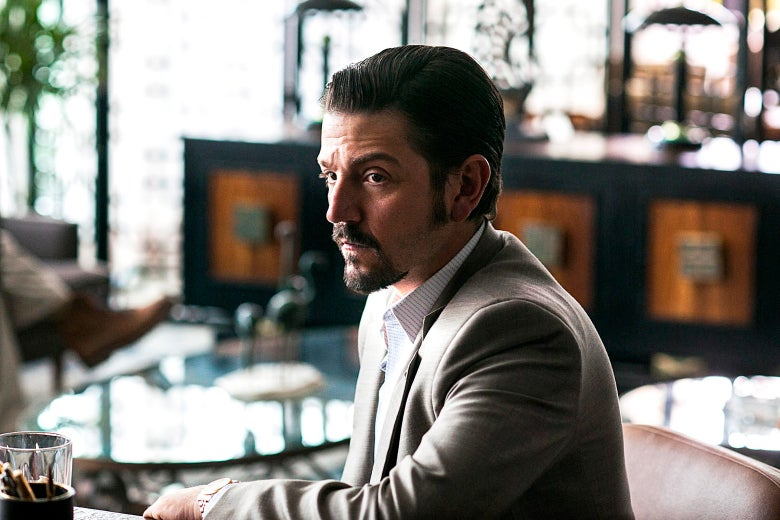 Diego Luna's character in a cafe or bar.