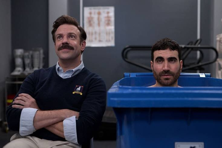 Jason Sudekis and Brett Goldstein in the physical therapy room on Ted Lasso.