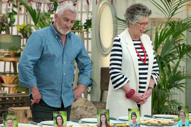 Paul Hollywood and Prue Leith look down in disappointment at a row of tarts.