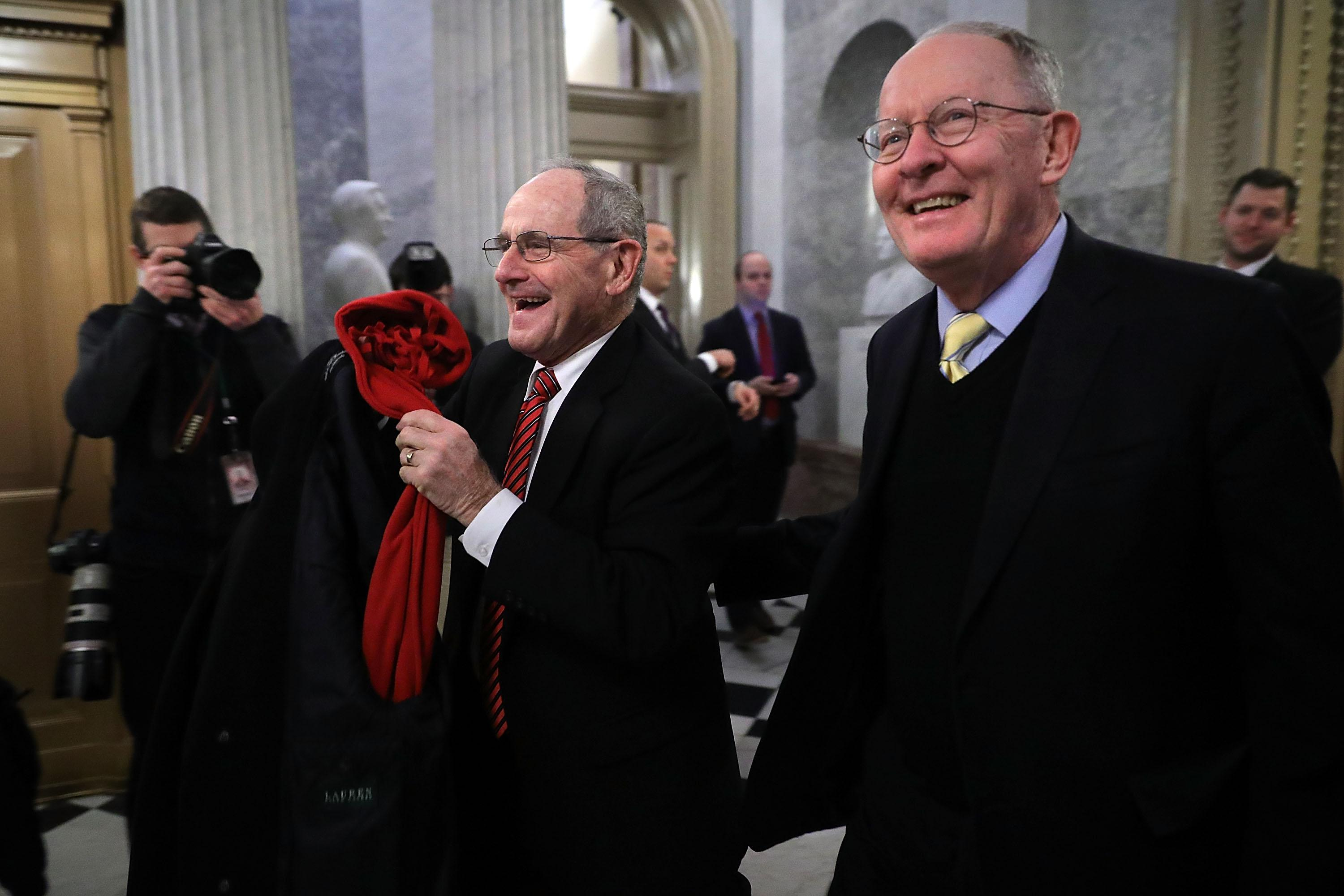 Sen. Lamar Alexander (right).