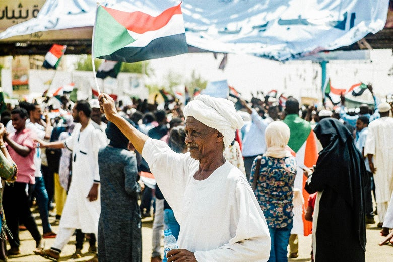 A Sudanese man waves a national flag during a rally demanding a civilian body to lead the transition to democracy on Friday in Khartoum.