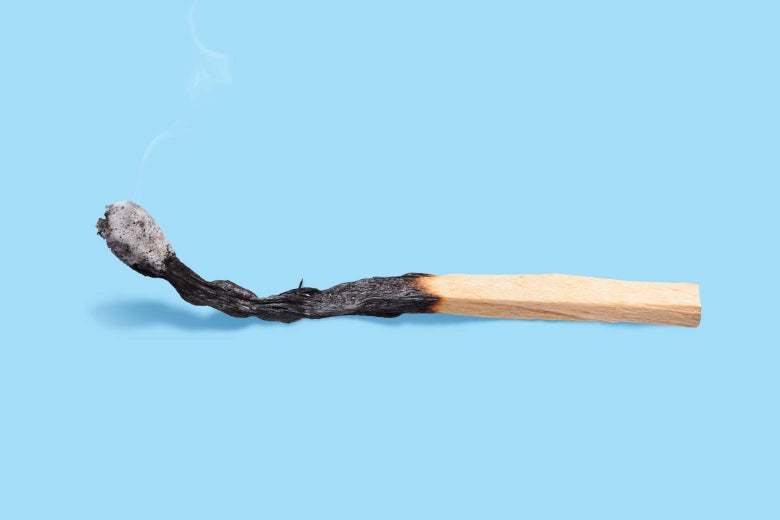 Photo illustration of a burnt match against a blue background.