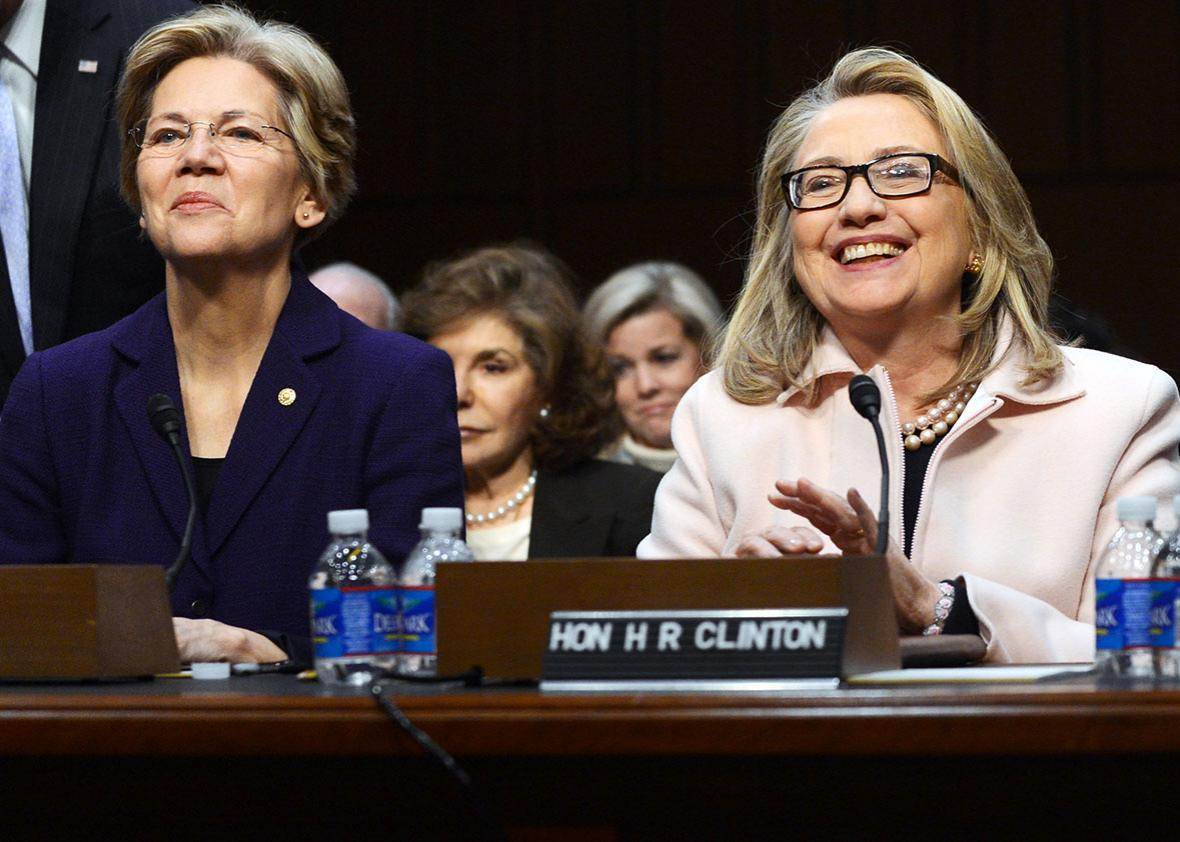 Sen.Elizabeth Warren,D-MA and Secretary of State Hillary Clinton are seated before John Kerry's confirmation hearings before the Senate Foreign Relations committee on Capitol Hill in Washington, DC, on January 24, 2013.