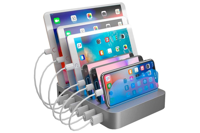 Charging station with several tablets and smartphones docked in it