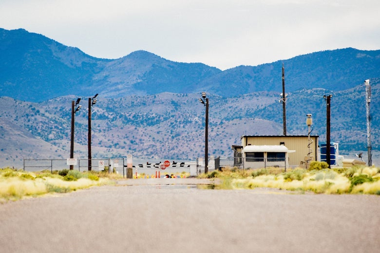 A gate to a military base amid the mountains and desert.