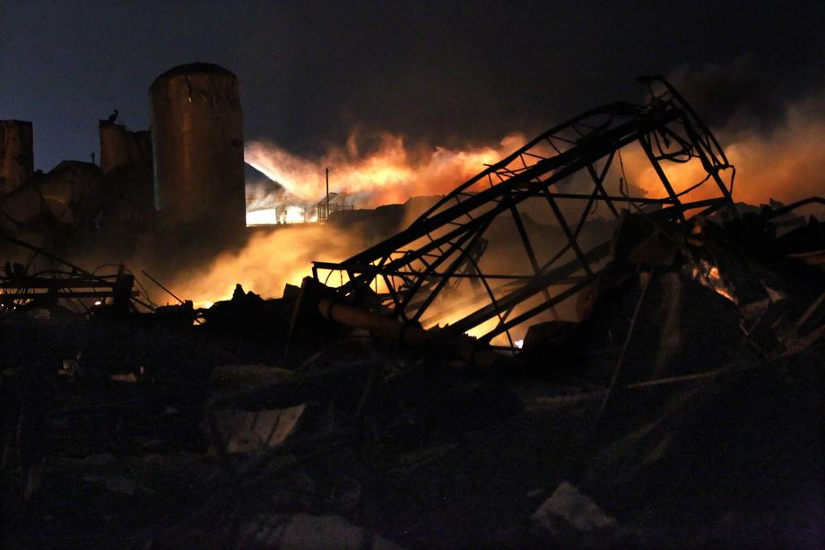 Smoke rises as water is sprayed at the burning remains of a fertilizer plant after an explosion at the plant in the town of West, near Waco, Texas early April 18, 2013.