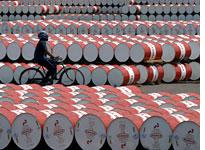 Barrels filled with fuel in Jakarta. Click image to expand.