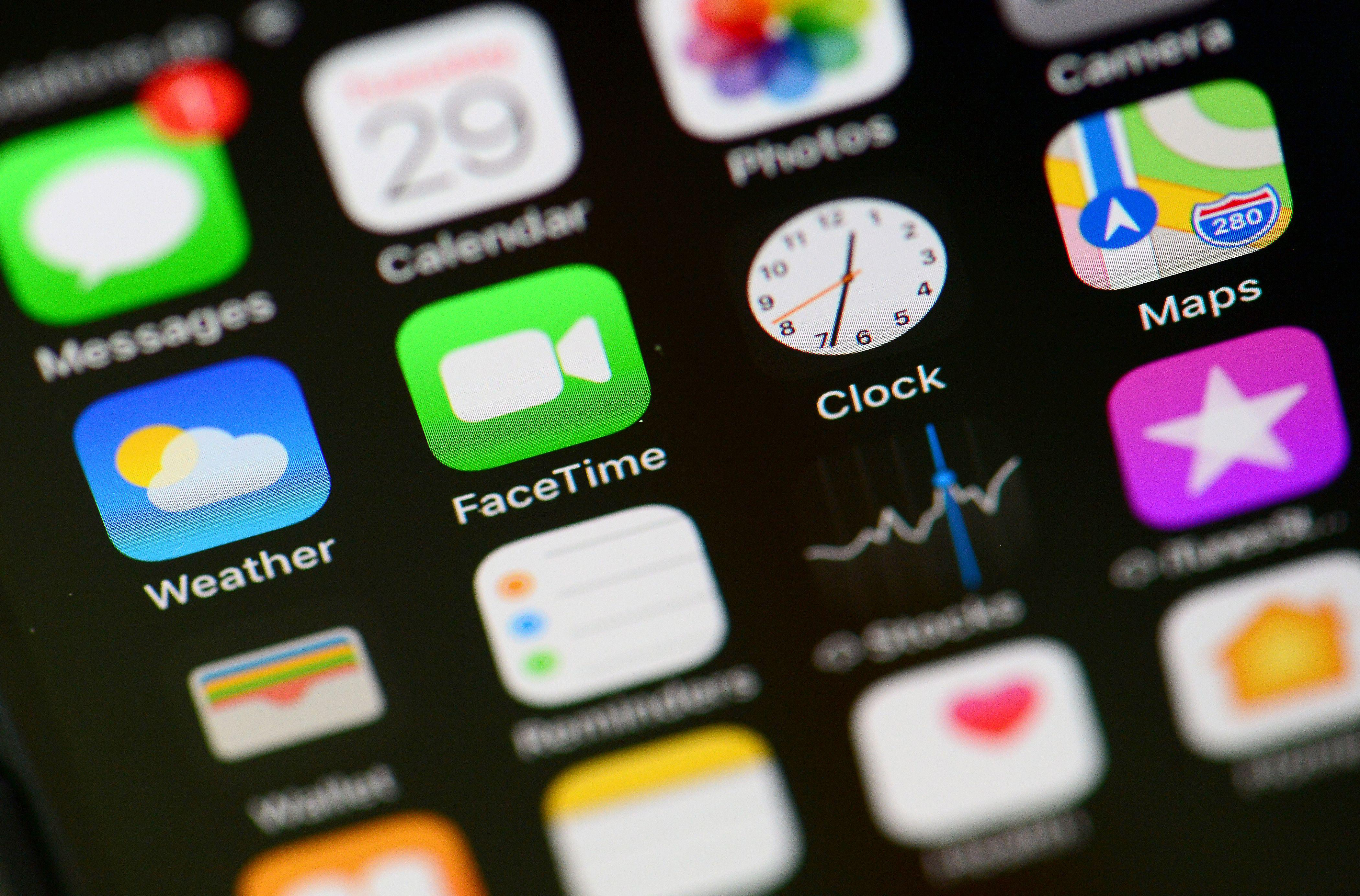 The logo of FaceTime (2nd in the second row from top) is pictured on an Iphone screen in Berlin on January 29, 2019. - A newly discovered FaceTime bug lets people hear and even see those they are reaching out to on iPhones using the video calling software, sparking privacy fears. (Photo by Odd ANDERSEN / AFP)        (Photo credit should read ODD ANDERSEN/AFP/Getty Images)