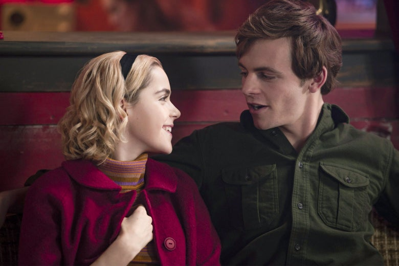 Kiernan Shipka's character looks googly-eyed at a boy sitting next to her.
