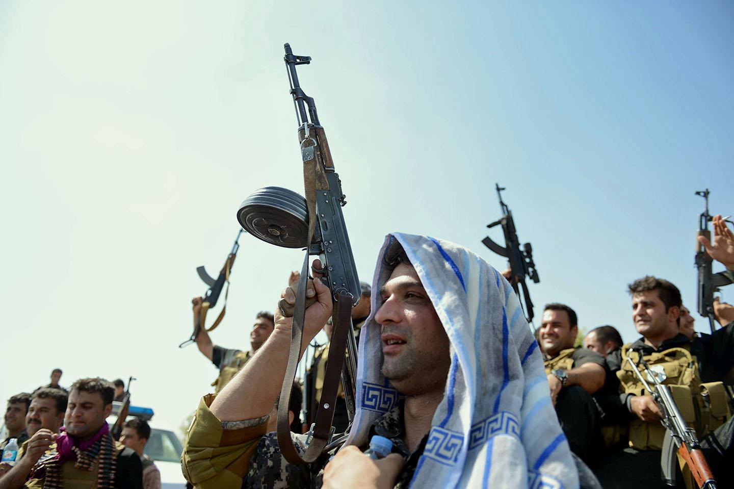A militant Islamist fighter takes part in a military parade along the streets of Syria's northern Raqqa province.