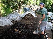 Francesco shoveling compost