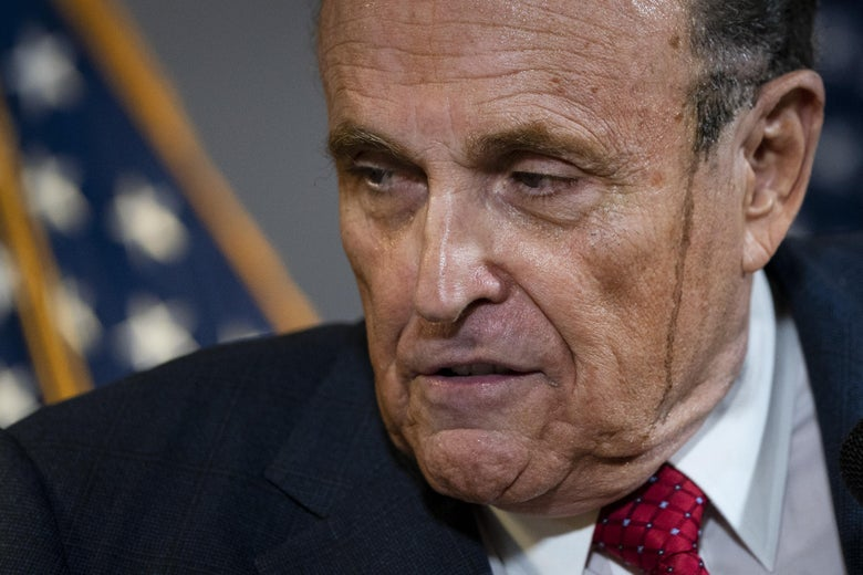 Close-up of Giuliani's face with a smear from apparent hair coloring running down the side of his face