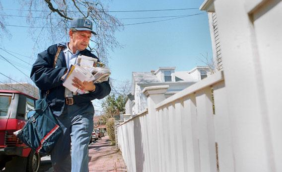 Mailman on his route in Cambridge, Mass.