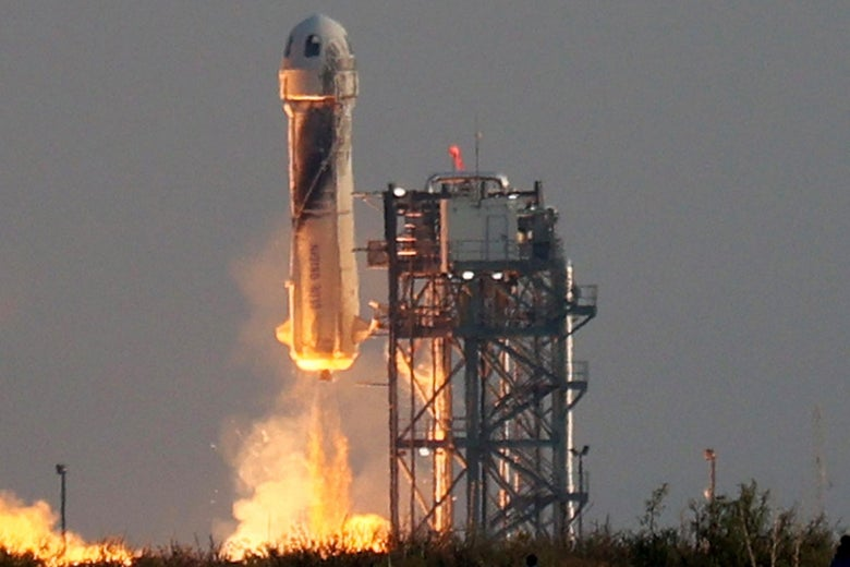 Blue Origin's New Shepard lifts-off from the launch pad, looking a great deal like a penis.