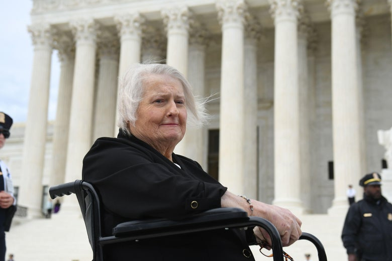 Transgender activist Aimee Stephens sits in her wheelchair outside the U.S. Supreme Court building.