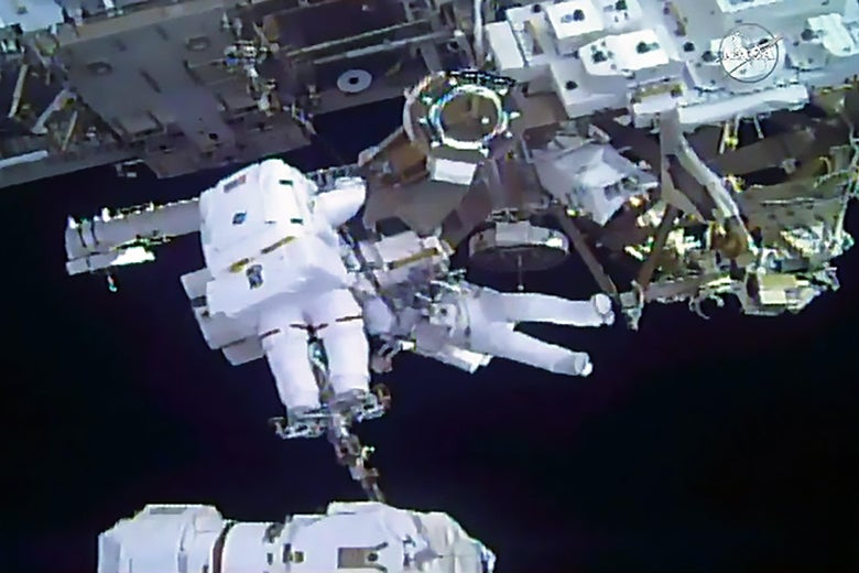 This still image from video courtesy of NASA shows spacewalkers Mark Vande Hei of the US (foreground) and Norishige Kanai of Japan transferring a spare robotic hand to a long-term stowage area on the International Space Station, February 16, 2018.   A Japanese and an American astronaut floated for hours outside the International Space Station on a spacewalk to repair the orbiting outpost's robotic arm and move some equipment into storage. The spacewalk, broadcast live on NASA TV, was the first for Japanese Aerospace Agency (JAXA) astronaut Norishige Kanai, and the fourth for his US counterpart Mark Vande Hei.  / AFP PHOTO / AFP PHOTO AND NASA / NASA        (Photo credit should read NASA/AFP/Getty Images)