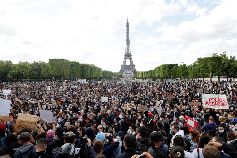Protesters gather on Champ de Mars, in Paris on June 6, 2020, as part of Black Lives Matter worldwide protests against racism and police brutality in the wake of the death of George Floyd, an unarmed black man killed while apprehended by police in Minneapolis.