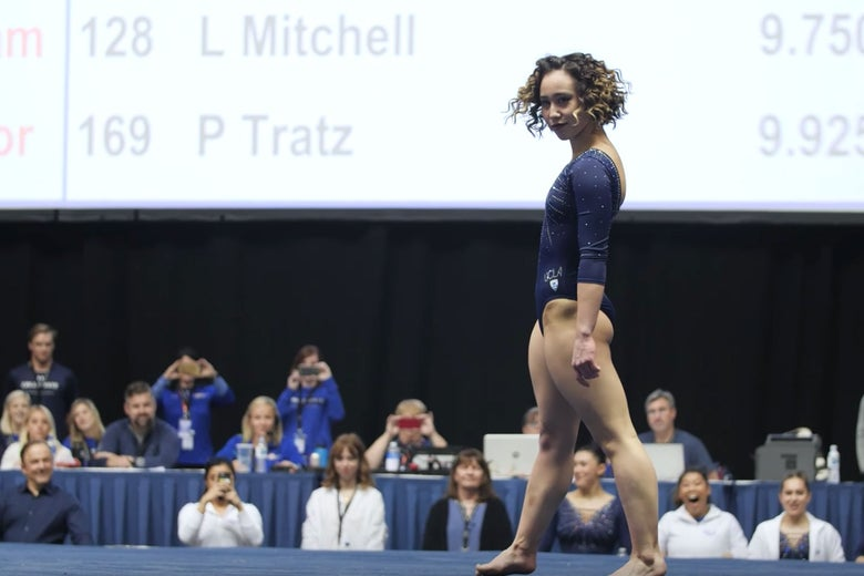 Katelyn Ohashi throws a sassy expression directly at the camera at the end of her floor exercise routine.