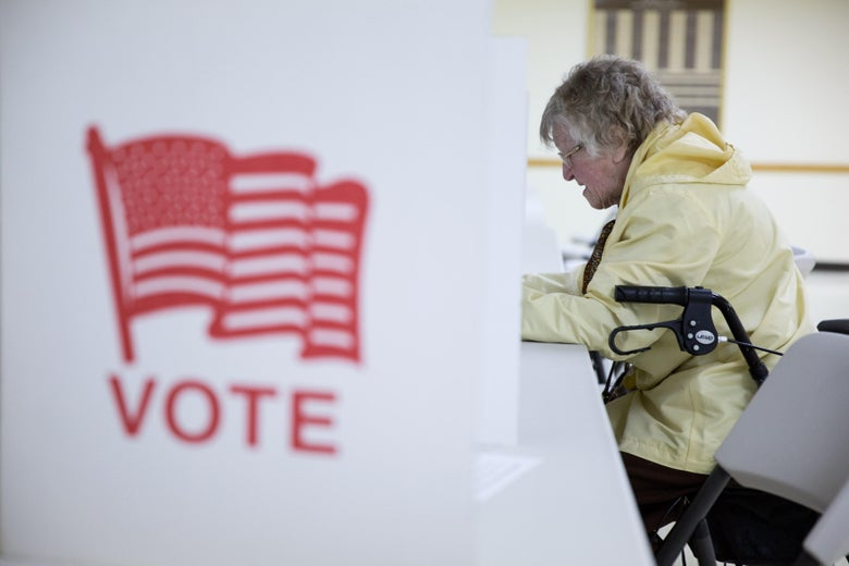 A voter fills out her ballot in New Hampshire.