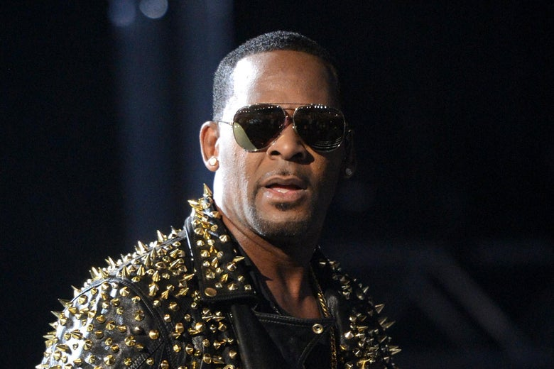 R. Kelly performs in studded black leather jacket and sunglasses.