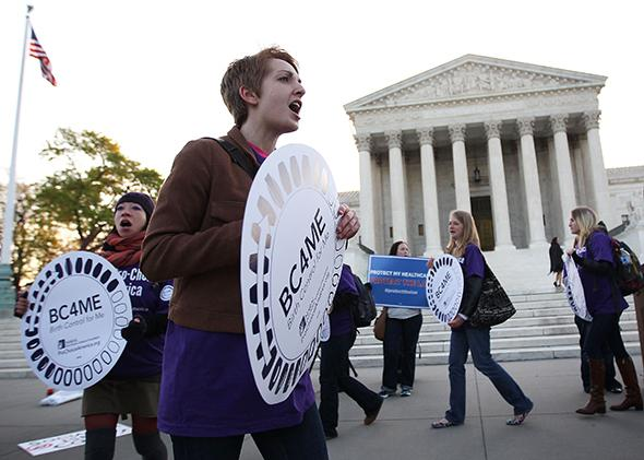 Pro-Obamacare supporters shout slogans in front of the U.S. Supreme Court on March 27, 2012 in Washington, D.C.