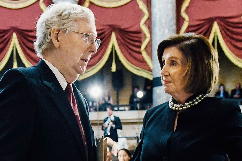 Mitch McConnell and Nancy Pelosi look at each other.