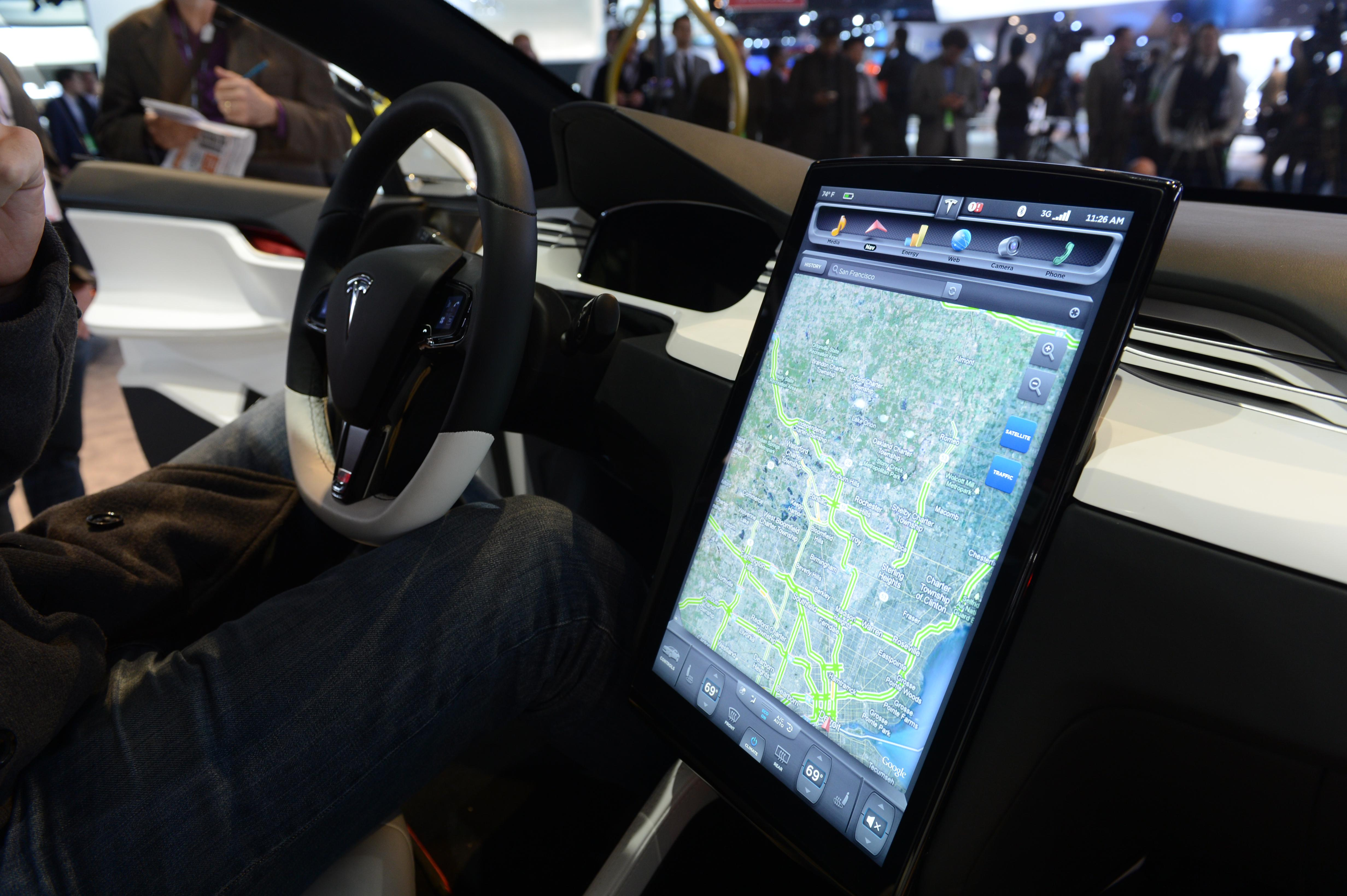 The Tesla Model X computer screen mounted on the dashboard is introduced at the 2013 North American International Auto Show in Detroit.