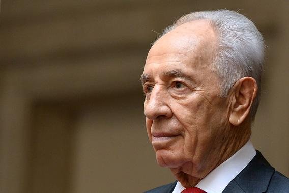 Israeli President Shimon Peres is pictured as he is welcomed by Italian Prime Minister at Chigi Palace in Rome on April 30, 2013.