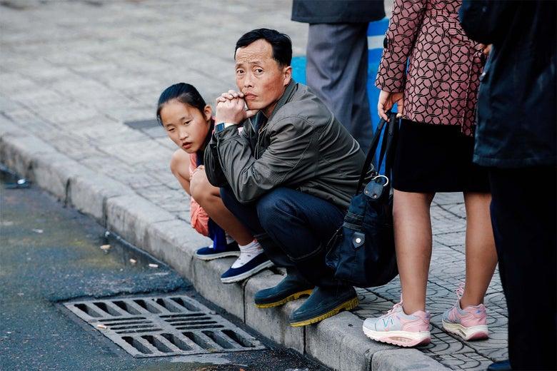 People wait for a bus in central Pyongyang, North Korea.
