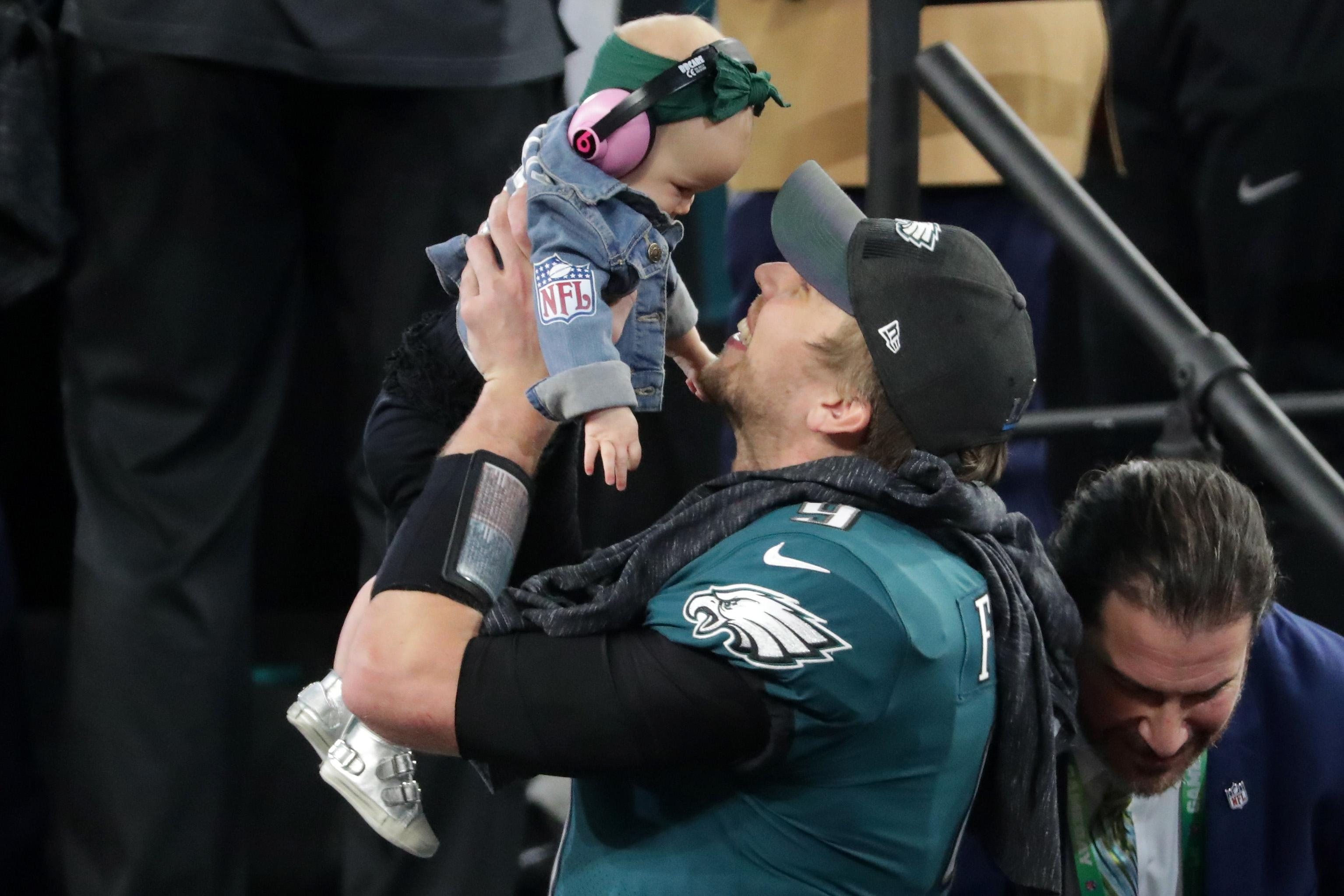 MINNEAPOLIS, MN - FEBRUARY 04:  Nick Foles #9 of the Philadelphia Eagles celebrates with his daughter Lily Foles after his 41-33 victory over the New England Patriots in Super Bowl LII at U.S. Bank Stadium on February 4, 2018 in Minneapolis, Minnesota. The Philadelphia Eagles defeated the New England Patriots 41-33.  (Photo by Streeter Lecka/Getty Images)