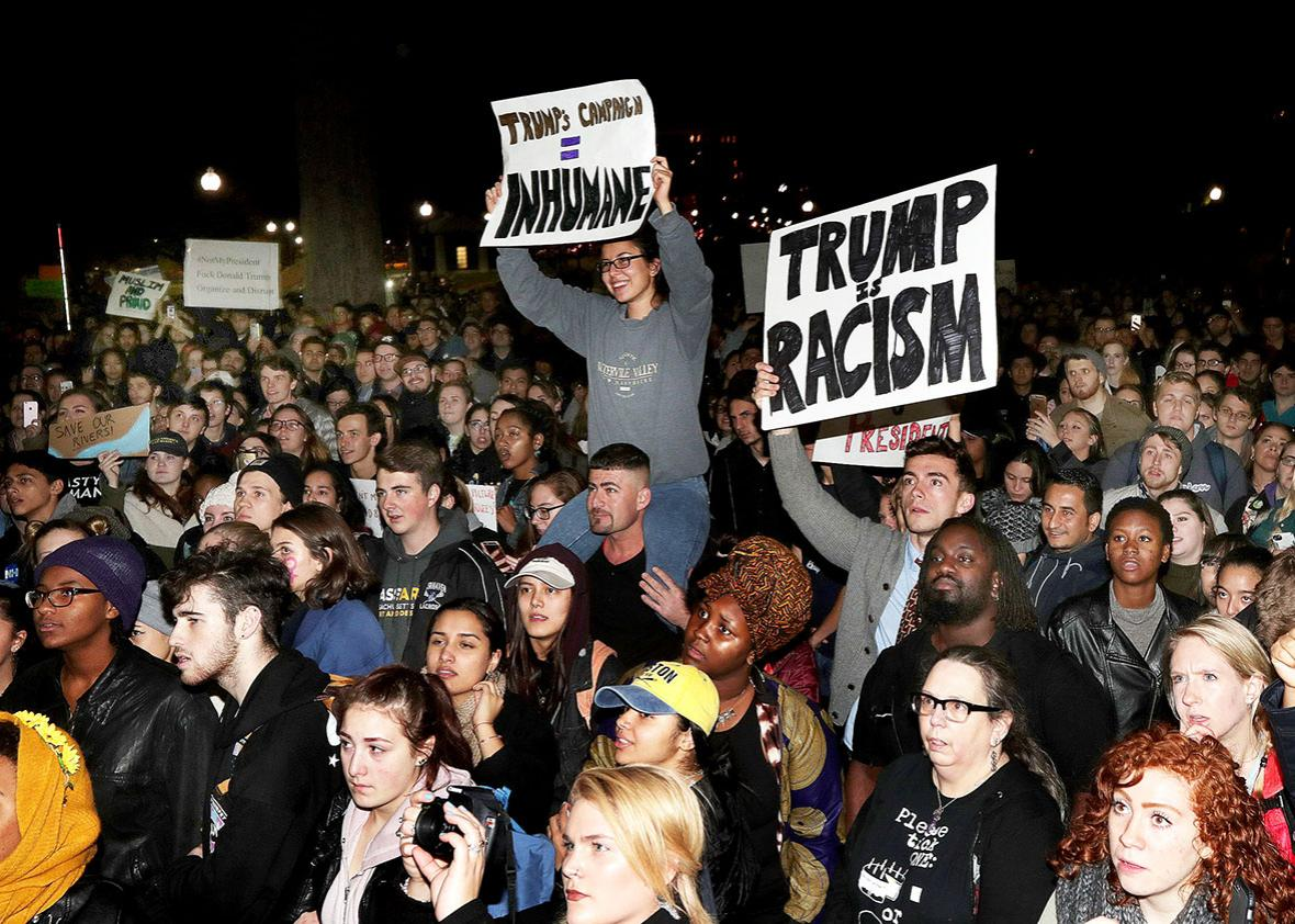 Demonstrators gather to rally against Donald Trump as President at the Parkman Bandstand in Boston Common in Boston on Nov. 9, 2016.