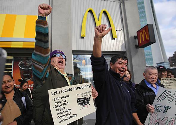 Activists chant for higher wages outside a McDonald's.