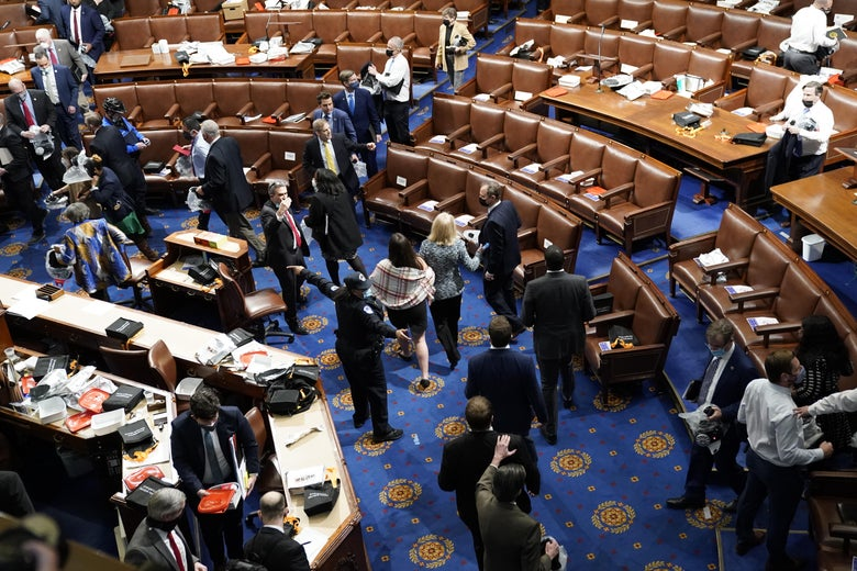 High-angle shot of the House floor with people leaving the chamber
