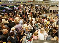 Passengers wait at Heathrow Airport. Click image to expand.