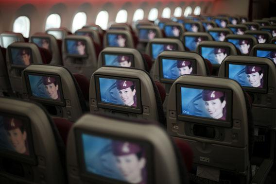 Seats and screens in the economy class cabin of Qatar Airways new Boeing 787 Dreamliner after it arrived on it's inaugural flight to Heathrow Airport, West London Dec. 13, 2012.