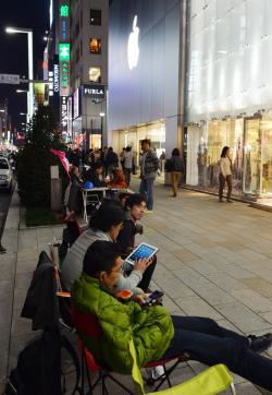 The Apple Army awaits their iPistols outside the Apple Store in Tokyo