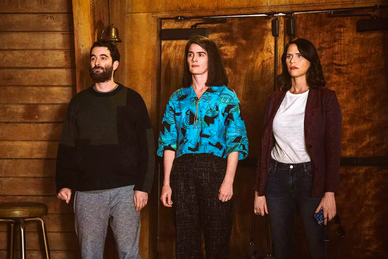 Jay Duplass, Gaby Hoffmann and Amy Landecker stand in front of a wooden door, all looking bewildered.