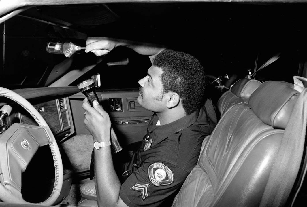 July 9, 1986: Agent Pratt dusting a recovered stolen car for fingerprints