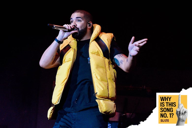 Drake, wearing a puffy vest, obviously
