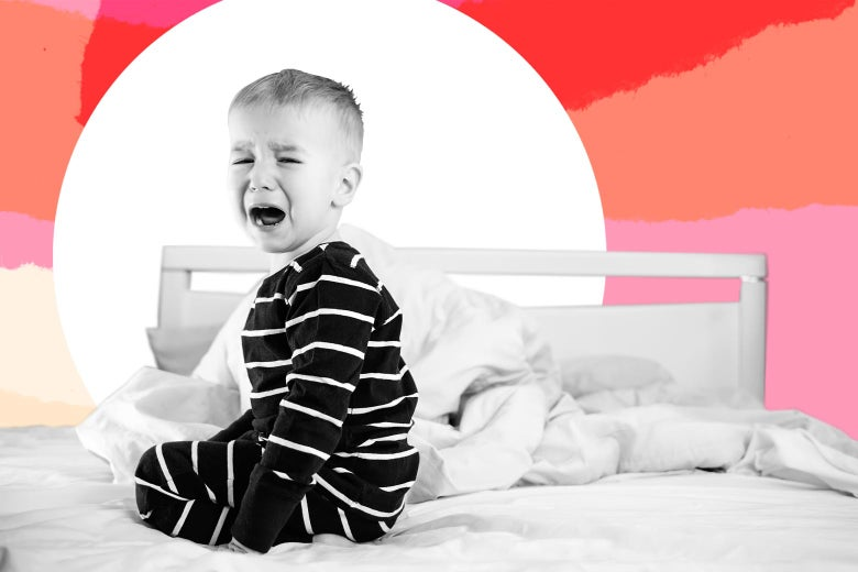 A toddler crying on a bed, refusing to nap.