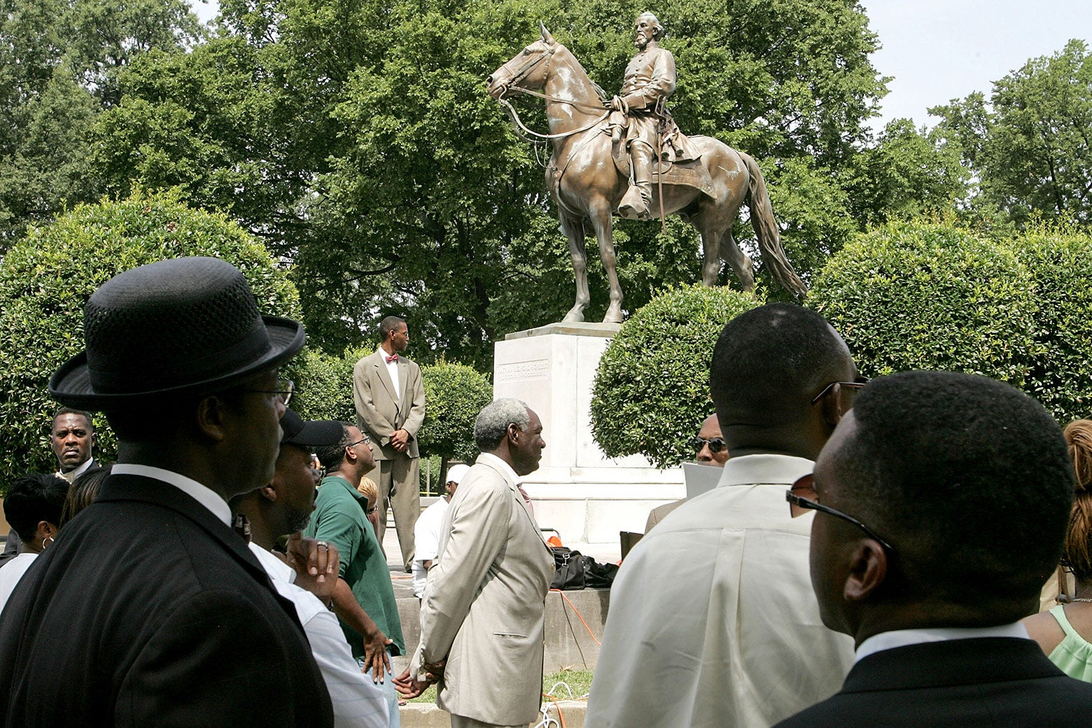 Protesters attend a rally  against the name of Nathan Bedford Forrest Park in front of a statue bearing his likeness Aug. 13, 2005, in Memphis, Tennessee.