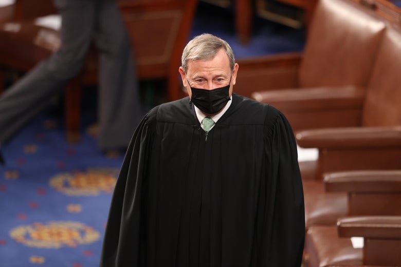 John Roberts in his robe and a simple black mask.