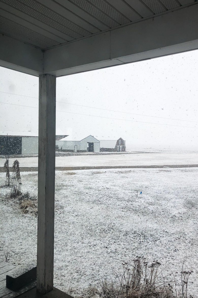 A farm field covered in snow.