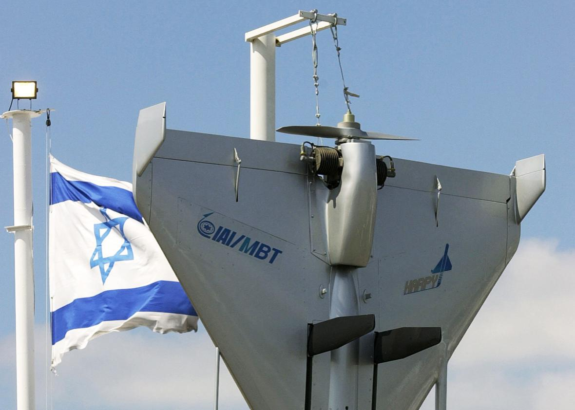 An Israeli flag flutters next to an Harpy IAI-MBT Attack Drone as part of the Israeli display during the 44th Paris Air Show at Le Bourget Airport, north of Paris, France, June 21, 2001.